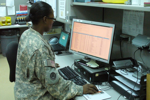 Staff Sgt. Stephonee Payne, a pharmacist with the 325th Combat Support Hospital, processes medical supply orders for the U.S. Military Hospital Kuwait using the DMLSS 3.1.2 Prime Vendor Generation IV app upgrade.