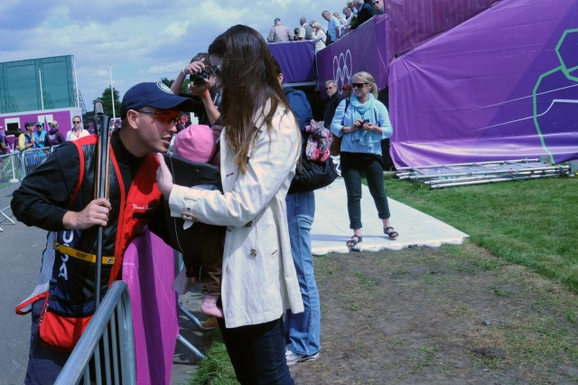 Sgt. Vincent Hancock kisses his 5-month-old daughter Brenlyn, held by his wife Rebekah, following an almost-perfect day in which he shot 74 out of 75 clay pigeons, July 30, 2012, at the Royal Artillery Barracks in London. He leads the field of Olympic men's skeet going into the final day of competition.