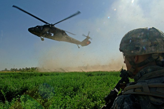A U.S. Army Soldier prepares to board a UH-60 Black Hawk helicopter landing near Tafaria, Iraq in 2006. Historically military maintenance programs have relied on time-scheduled maintenance. The U.S. Army Research Laboratory is looking into new aircraft maintenance technologies that could get safer aircraft back in the air faster.