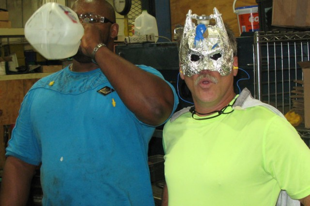 RRAD's new superhero Captain Hydrate makes sure an employee drinks water during a safety walk. The hero is responsible for making sure employees keep hydration levels high during summer months.