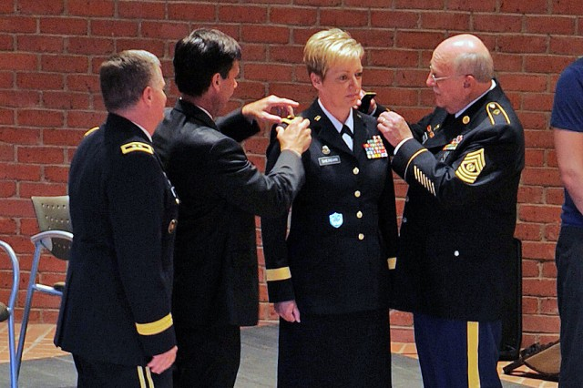 "The Louisiana National Guard welcomed its first female general officer during a promotion ceremony, July 27, 2012, at the Jackson Barracks Museum in New Orleans. Col. Joanne F. Sheridan, the Louisiana National Guard's assistant adjutant general-Army, was promoted to the rank of brigadier general and ""pinned"" the one-star insignia on her uniform."