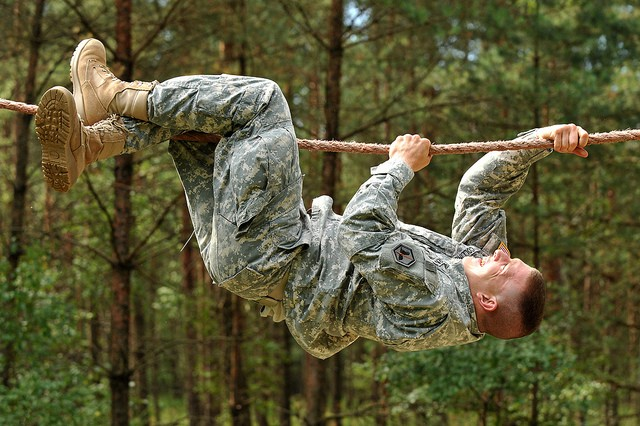 GRAFENWOEHR, Germany --- U.S. Army Sgt. Timothy Collins, 66th Military Intelligence Brigade, goes across the rope bridge at the obstacle course during United States Army Europe's Best Warrior Competition in Grafenwoehr, Germany, July 30.