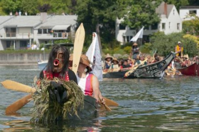 In the final step of their canoe journey, Native Americans row toward the ramp to have their watercraft pulled onto land for the Paddle to Squaxin 2012. Soldiers from the 295th Quartermaster Company from Joint Base Lewis-McChord, Wash., participated in the event by helping to pull the canoes out of the water.