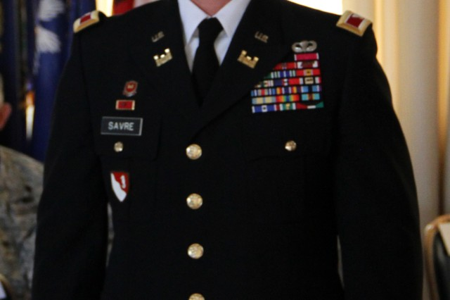 U.S. Army Corps of Engineers North Atlantic Division Commander Col. Kent D. Savre prepares to receive the division's flag at an Assumption of Command ceremony July 31 at the Fort Hamilton Community Club. From his Brooklyn headquarters, Savre will direct a 3,500-member workforce and a multi-billion annual program in civil works, military construction, and environmental restoration that spans 14 states throughout the Northeast as well as overseas in Europe and Africa.