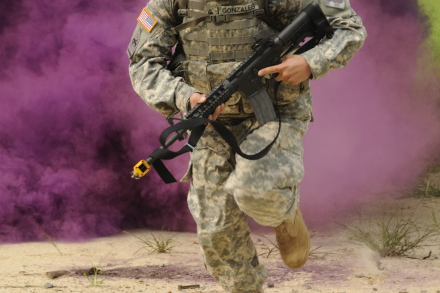 Staff Sgt. John Gonzales, 1st Battalion 40th Field Artillery, participates in warrior task exercise during the 2012 TRADOC NCO/Soldier of the Year Competition.