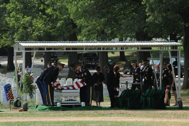 A casket team, 3d U.S. Infantry Regiment (The Old Guard), lifts an American Flag from a casket prior to folding it during a funeral honoring Staff Sgt. Carl E. Hammar, 4th Airborne Brigade Combat Team, 25th Infantry Division, in Arlington National Cemetery, Va., July 30, 2012.  The flag was presented to Hammar's daughter, Valeria Hammar, as a token of our nation's gratitude for his sacrifice. (U.S. Army photo by Spc. Devin Kornaus)