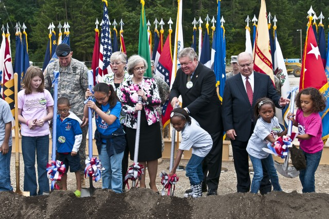 Undersecretary of the Army Joseph W. Westphal (back row, far right), Lt. Gen. Robert Brown (back row, far left), commanding general of I Corps and Joint Base Lewis-McChord, Wash., and Washington State Congressional Delegation and Clover Park School District representatives shovel dirt on the future site of JBLM's Hillside Elementary School, July 30, 2012. The groundbreaking ceremony signified the official start of a year-long construction project to completely rebuild Hillside and Carter Lake Elementary Schools on JBLM within the next year.