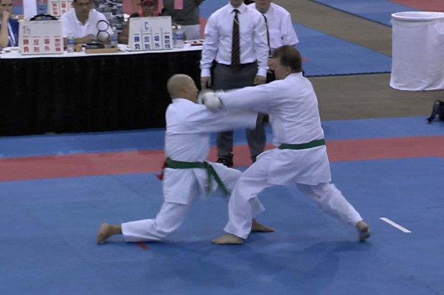 Sgt. Randal Kumagai (fighter on the left), military intelligence for the 8th Theater Sustainment Command, blocks a strike and counters during the Amateur Athletic Union Karate National Championships in St. Charles, Illinois, July 4-7.