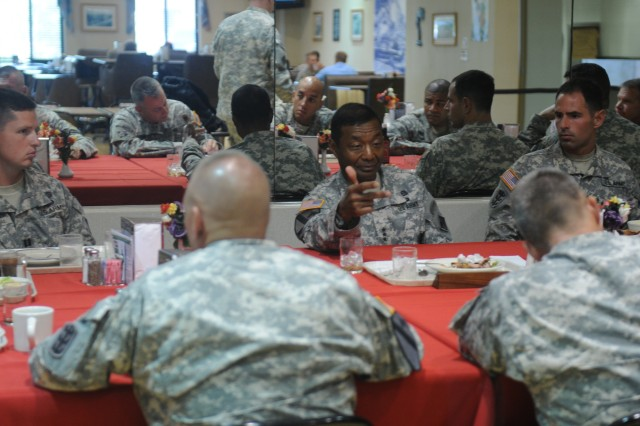 Chief of Engineers Lt. Gen. Thomas Bostick (center) has lunch with company commanders and first sergeants from the 130th Engineer Brigade, 8th Theater Sustainment Command sharing command philosophies, advice, and praise, July 24.