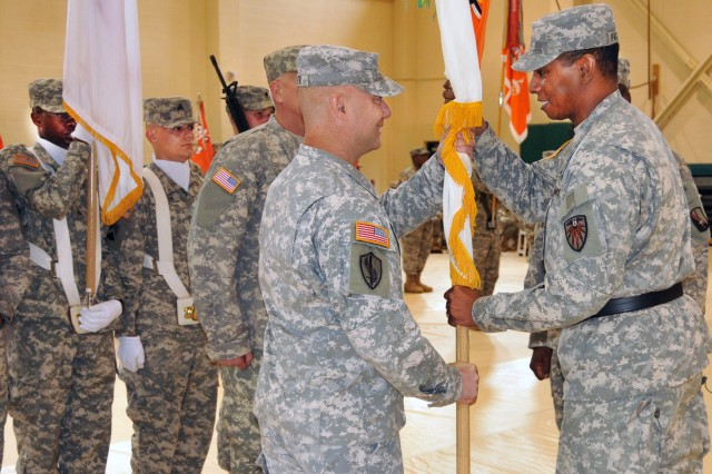 Brig. Gen. LaWarren V. Patterson, commanding general, 7th Signal Command (Theater), right, passes 21st Signal Brigade command colors to Col. Mark Baxter, incoming commander of the 21st Signal Brigade during a change of command ceremony at Fort Detrick recently.  Now major general and serving in a new assignment, Patterson commands the U.S. Army Signal Center of Excellence and Fort Gordon, Ga.