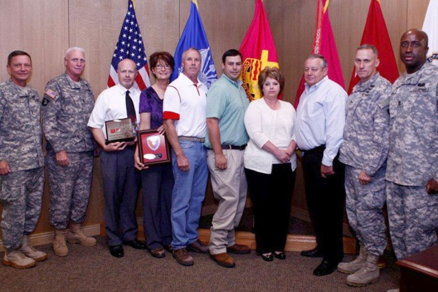 During a recent visit to the depot Maj. Gen. Michael J. Terry, commanding general, TACOM Life Cycle Management Command presents members of the RRAD Safety team with the Army Materiel Command 2011 Organizational Excellence Safety Award (Garrison Level) and the Secretary of Army/Chief of Staff Army 2011 Organizational Excellence Safety Award (Garrison Level). Members accepting the award were Bonnie Lewis, Roger Simmons, Greg Johnson, Bill Horton, Brent Jones and Ann Harmon. Also pictured are Command Sgt. Maj. Clinton G. Hall, RRAD Commander Col. Doyle Lassitter and Depot Sgt. Maj. Gregory E. Tubbs.