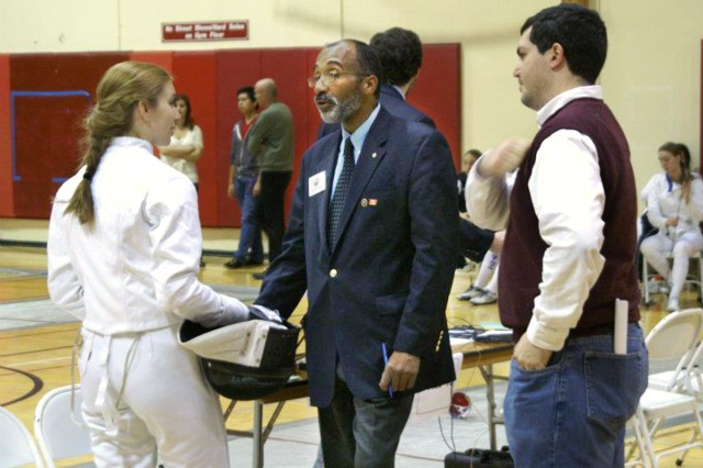 Gauntner listens as a referee talks to one of his fencers. Courtesy photo.