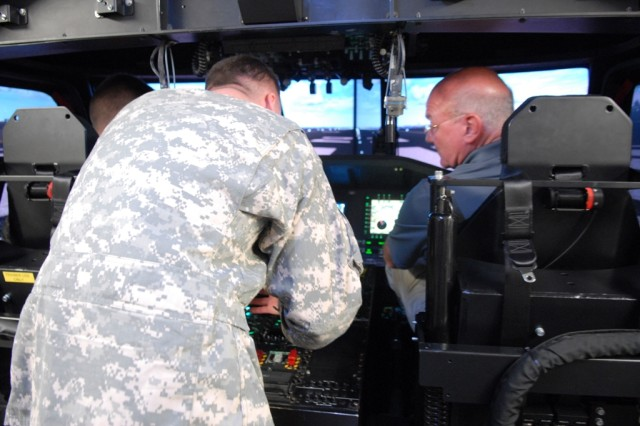 Thomas R. Lamont, assistant secretary of the Army for Manpower and Reserve Affairs, utilizes a Transportable Black Hawk Operations Simulator at Fort Campbell, Ky., July 25, 2012. Lamont visited Fort Campbell to discuss force manning and manpower issues as well as observe several aspects of training.