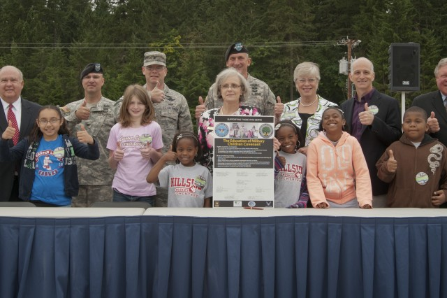 Civil and Military Leaders along with local school children stand proud at Joint Base Lewis-McChord, Wash., right after signing an Education of Military Children Covenant during a groundbreaking ceremony signifying the official start of a yearlong construction project to completely rebuild the installation's Hillside and Carter Lake Elementary Schools, July 30, 2012, at Joint Base Lewis-McChord, Wash. Westphal visited the base to gain situational awareness of the progress of the ACAP program, to help break ground on a school rebuilding initiative, and to inspect advances in telecommunication healthcare.