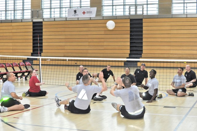 Soldiers play an adaptive sport game of volleyball in the Wiesbaden Fitness Center, Germany.