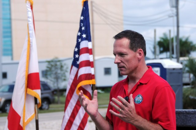 Florida State Representative Gary Aubuchon speaks during a ground breaking ceremony for a new Army Reserve center in Cape Coral, Florida on July 28.