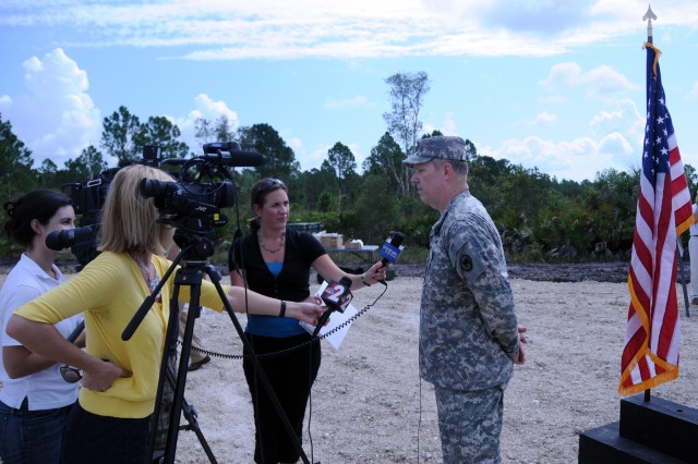 Col. Patrick Briley, Director of Public Works for the 81st Regional Support Command at Fort Jackson, S.C., is interviewed by Cape Coral Florida affiliates of CBS, FOX and NBC regarding the groundbreaking for a new Army Reserve center on July 28.