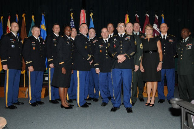 The 14 Soldiers and one civilian who retired during a ceremony July 27 at the Post Theater.