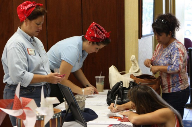 """Jackie Crogan and Tina Tucker dressed as Rosie the Riveter for the Fort Rucker Community Spouses Club Super Sign-Up event last fall. The theme was """"We can do it """" together!"""""""