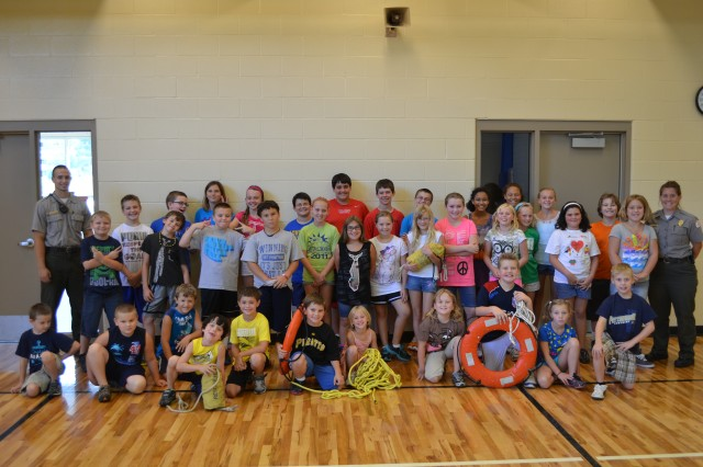 Crooked Creek Lake Rangers Travis November and April Hawkey flank children who attended the water safety program at the Kittanning YMCA.