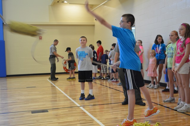 """Children had a chance to practice throwing a water safety throw bag to a drowning """"victim"""" during a Corps of Engineers water safety day program."""