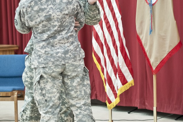 "Brig. Gen. Bud R. Jameson Jr., a resident of Sherwood, Ark., and Command Sgt. Maj. Michael Bolduc, a resident of Methuen, Mass., place the 316th Sustainment Command (Expeditionary) patch on each other's right sleeves during a ceremony for the Soldiers of the 316th. The ceremony commemorates the earning of the unit's patch as their shoulder sleeve insignia former-wartime service at Camp Arifjan, Kuwait, Aug. 2. ""I want you to be able to wear this patch with pride, knowing the legacy that you build here is going to be unmatched in the ESC and sustainment community,"" said Jameson, the commanding general of the 316th."