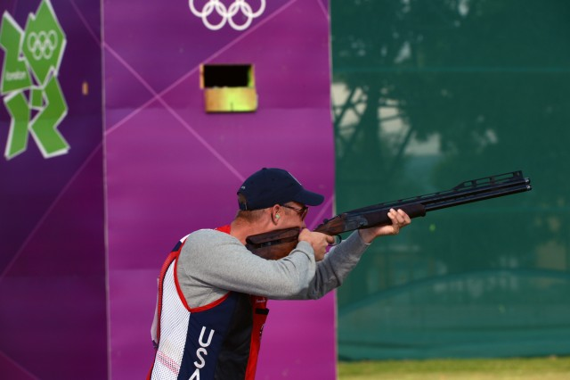 U.S. Army Marksmanship Unit shotgun shooter Sgt. Glenn Eller shoots the opening round of Olympic men's double trap qualification, Aug. 2, 2012, morning at the Royal Artillery Barracks range in London. Eller, the defending Olympic gold medalist, had two double misses in the first round that contributed to a drop from medal contention.