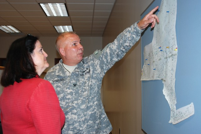 UTICA, NY- Col.  Ray Shields, New York National Guard Director of Joint Staff, points out the locations of New York Army National Guard armories and maintenance facilities to Katherine Hammack, Assistant Secretary of the Army for Installation, Energy and Environment, during an installation visit to the Utica Armory on Thursday, August 2.
