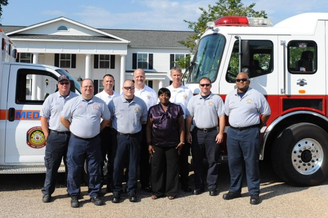 Members of Anniston Army Depot's Fire and Emergency Services Division stand in front of Medic 1 and Engine 2. The division was recently honored as the Small Fire Department of the Year for Army Materiel Command.