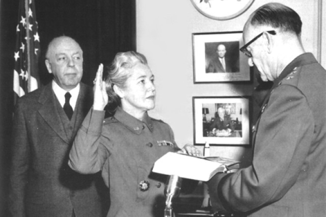 Col. Mary Louise Milligan is sworn in as the director of the Women's Army Corps by Maj. Gen. Herbert M. Jones, the adjutant general, Department of the Army, Jan. 3, 1957, as Secretary of the Army Wilber M. Brucker looks on.
