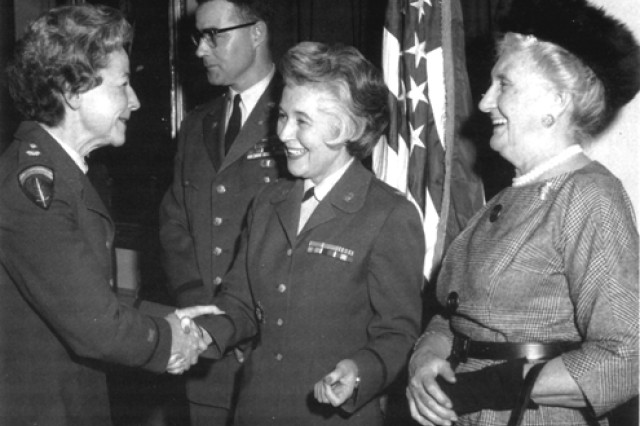 Col. Mary Louise Milligan receives congratulations upon her reappointment as the director of the Women's Army Corps from the deputy director, Lt. Col. Lucile G. Odbert, as Colonel Milligan's mother, George V. Milligan, proudly watches, Jan. 3, 1961.
