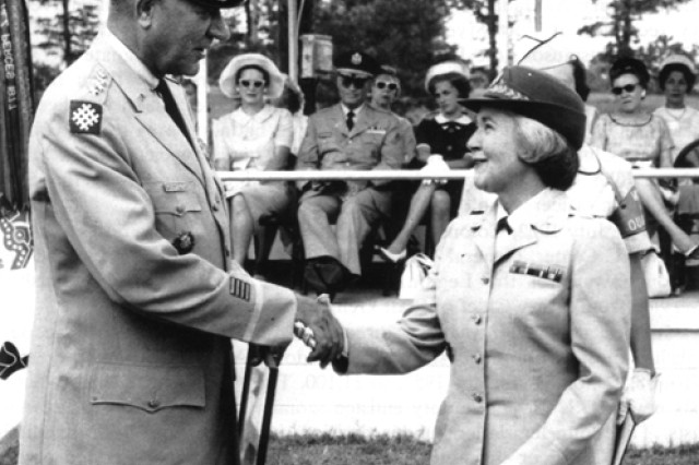 Col. Mary Louise Milligan Rasmuson and Lt. Gen. Russell L. Vittrup, Deputy Chief of Staff for Personnel, Department of the Army, at her retirement at Fort McClellan, Ala., July 31, 1962.