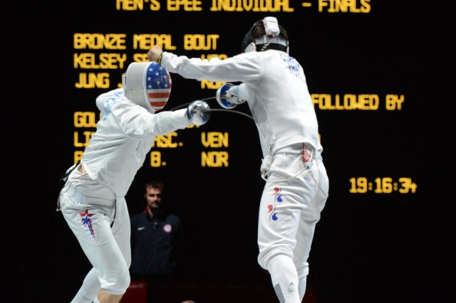 Air Force Capt. Seth Kelsey (left) stabs Korea's Jinsun Jung for a point during the Olympic bronze-medal bout in épeé fencing at the ExCel Centre in London Aug. 1. Jung prevailed in sudden-death overtime, 12-11.