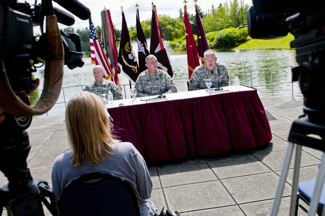 Colonel Dallas Homas (far right), commander of Madigan Army Healthcare System at Joint Base Lewis-McChord, Wash., speaks to members of the local media Aug. 2 during a press conference at Madigan to address the Army's recent decision to discontinue the use of forensic psychiatry as part of its disability evaluation system.