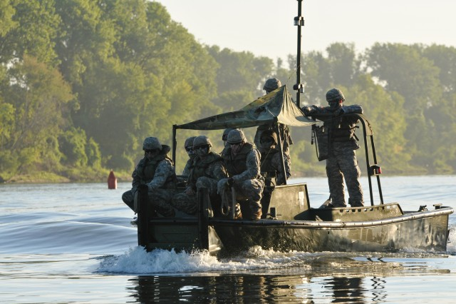 Combat engineers with 459th Engineer Company from Bridgeport, W.Va. prepare to maneuver sections of an Improved Ribbon Bridge in a Bridge Erection Boat on the Arkansas River July 26 at Fort Chaffee, Ark. The floating bridge, which took three hours to complete, was the culmination event during River Assault 2012.