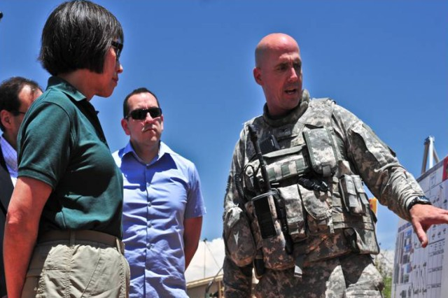 A Soldier walks Heidi Shyu, acting  assistant secretary for Acquisition, Logistics and Technology, through a testing exercise at a network integration evaluation at White Sands Missile Range, N.M. earlier this year.