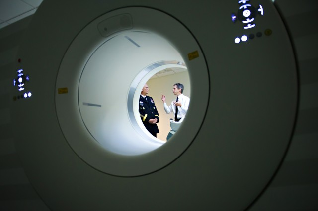 A research physiologist briefs Army Chief of Staff Gen. Raymond T. Odierno about the benefits of using magnetic resonance imaging scanners in the research of traumatic brain injuries, Aug. 2, 2012, at Walter Reed National Military Medical Center in Bethesda, Md.