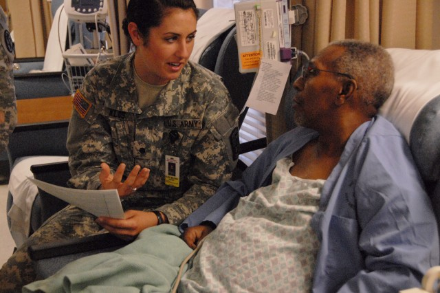 Priscilla Perry, a senior Army Reserve Officer Training Corps nursing cadet from New Mexico State University, listens as her preceptor for the day, registered nurse Patricia Luna, offers advice on patient care in the William Beaumont Army Medical Center's intensive care unit.