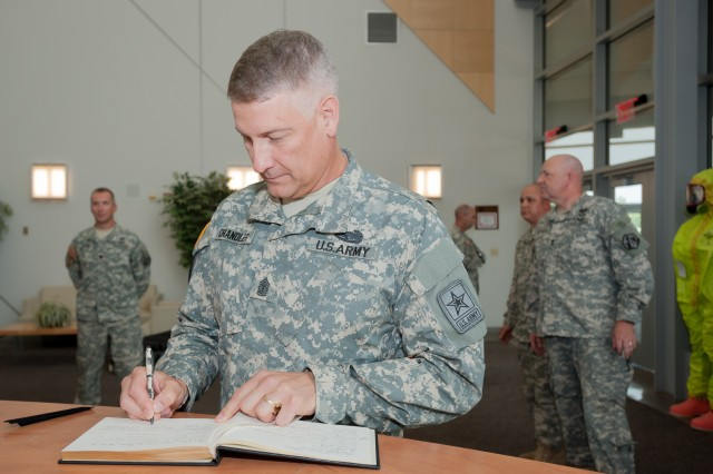 Sgt. Maj. of the Army, Raymond F. Chandler III signs the guest book at the 1st Lt. Joseph Terry Chemical, Biological, Radiological and Nuclear Responder Training Facility Aug. 2, 2012.