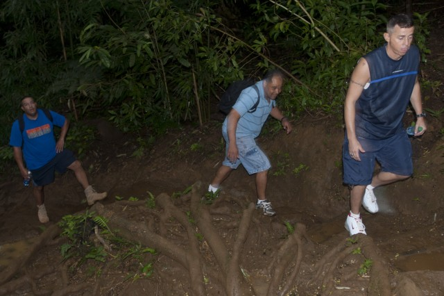 Three senior noncommissioned officers climb the Manoa Falls trail during senior NCO physical training, July 27. Senior NCO PT is a chance to get together outside of the work environment, and build relationships within the unit.