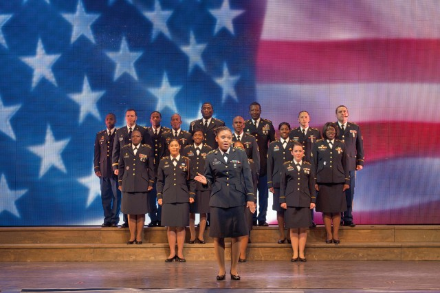 Pfc. Whiney M. Jones (center), human resource specialist and native of Orlando, Fla., leads her fellow Soldiers in a final medley during the 2012 Soldier Show at AMR, July 27.