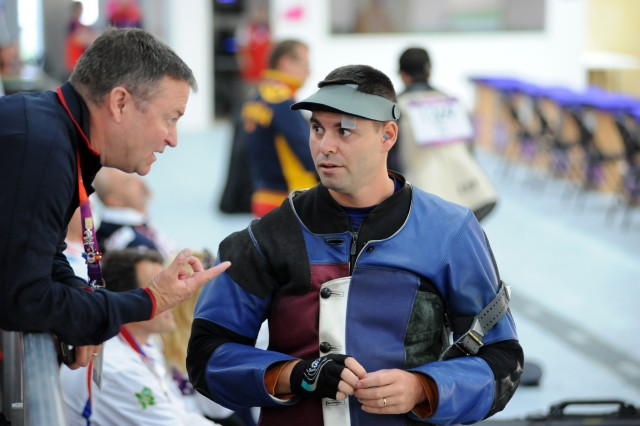 U.S. Army Marksmanship Unit shooter Staff Sgt. Michael McPhail (right) talks with Team USA rifle coach Maj. David Johnson of the U.S. Army World Class Athlete Progam during the Olympic men's 50-meter rifle prone competition Aug. 3, 2012, at the Royal Artillery Barracks in London. McPhail missed making the final by virtue of a shoot-off between nine marksmen for five spots in the final and finished ninth in the event.