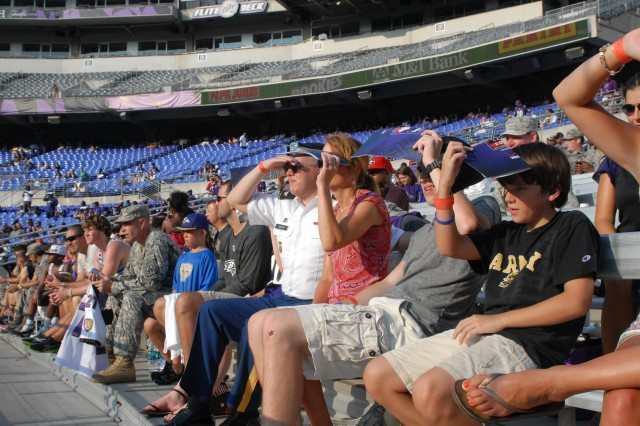 Service members and their families watch the Baltimore Ravens during the team's fifth annual Military Appreciation Day and open practice at M&T Bank Stadium in Baltimore, Md., held Aug. 4, 2012. The Ravens reserved approximately 3,500 seats for service members, veterans and military families.