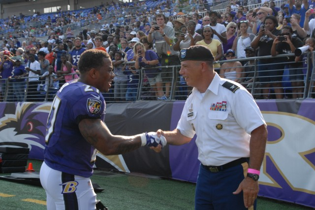 Ray Rice, Baltimore Raven runningback, shakes hands with Col. Edward C. Rothstein, Fort George G. Meade garrison commander, during the team's open practice and Military Appreciation Day at M&T Bank Stadium in Baltimore, Md., held Aug. 4, 2012. The Ravens reserved approximately 3,500 seats for service members, veterans and military families.