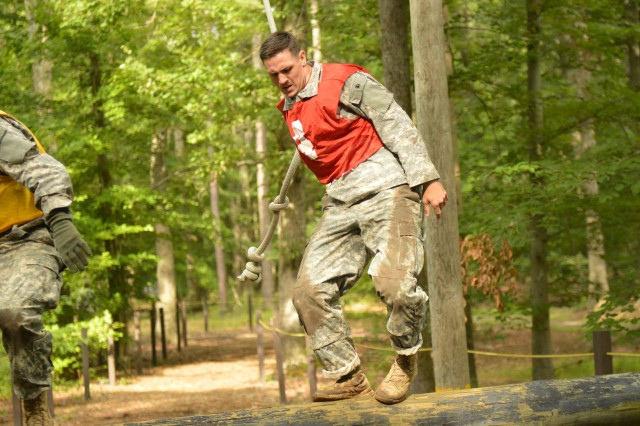 Staff Sgt. Brendan Shannon, Maneuver Center of Excellence, balances himself as he runs through the obstacle confidence course during the 2012 TRADOC Noncommissioned Officer and Soldier of the Year Competition held at Fort Eustis, Va.