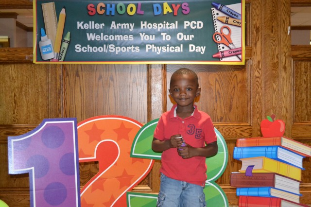 Pediatrics patient Stephon Hale poses for a photo at Keller Army Community Hospital's mass school physical day, Thursday, Aug 2.