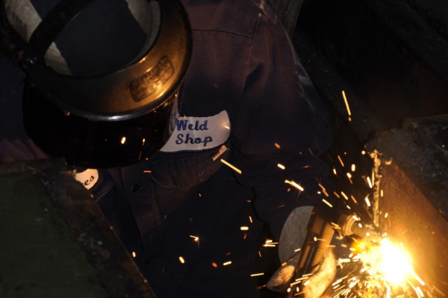 James Rockefeller, an Arsenal welder, cutting steel framework to make room for a new conveyor system during this year's annual shutdown.