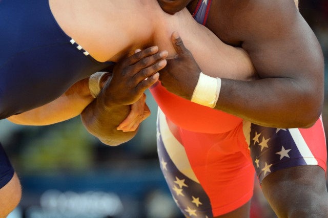 Sgt. 1st Class Dremiel Byers loses grapples with Turkey's Riza Kayaalp in the Olympic men's Greco-Roma 120-kilogram/264.5-pound wrestling tournament, Aug. 6, 2012, at ExCel North Arena in London. He lost the match 1-0, 1-0.