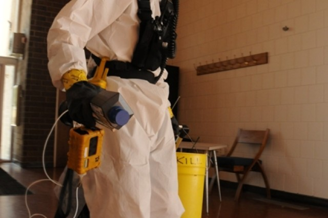 Staff Sgt. Spencer Roth, a survey team chief with the 52nd Civil Support Team, Ohio National Guard, searches a building for signs of contamination during exercise Vibrant Response at Muscatatuck Urban Training Center in southern Indiana, July 29, 2012.