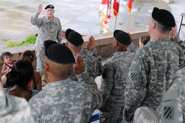 Chief of Staff of the Army Gen. Raymond T. Odierno reenlists 30 Dog Face Soldiers from the 3rd Infantry Division at Fort Stewart, Ga., Aug. 6, 2012, during his first trip to the home of the Marne Division since being sworn in as the 38th Chief of Staff of the Army on Sept. 7, 2011.